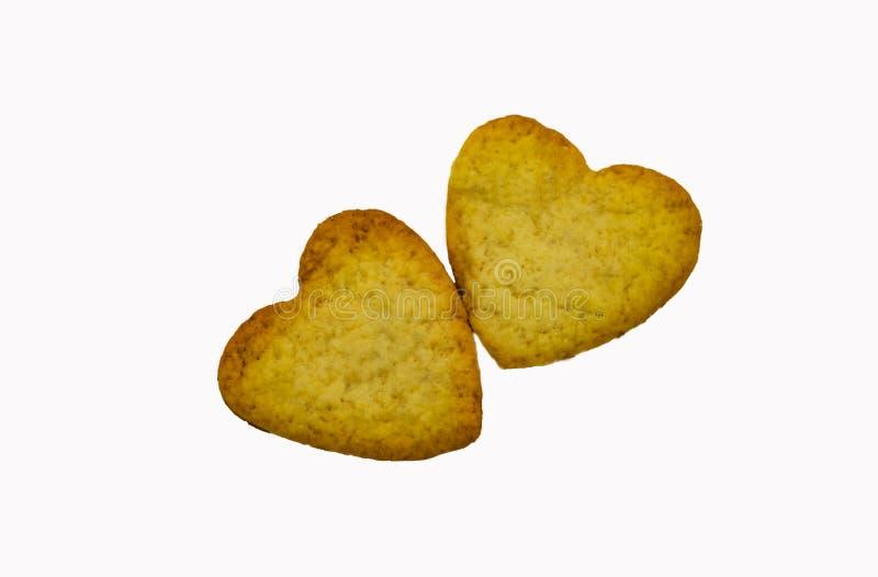 曲奇饼在一个白色背景特写镜头的两心脏 免版税库存图片