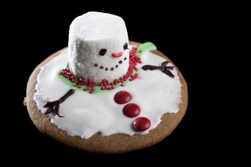 曲奇饼熔化的雪人 图库摄影