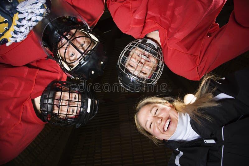 曲棍球杂乱的一团球员妇女 免版税库存照片