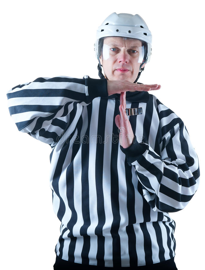 曲棍球裁判员展示暂停姿态 库存图片