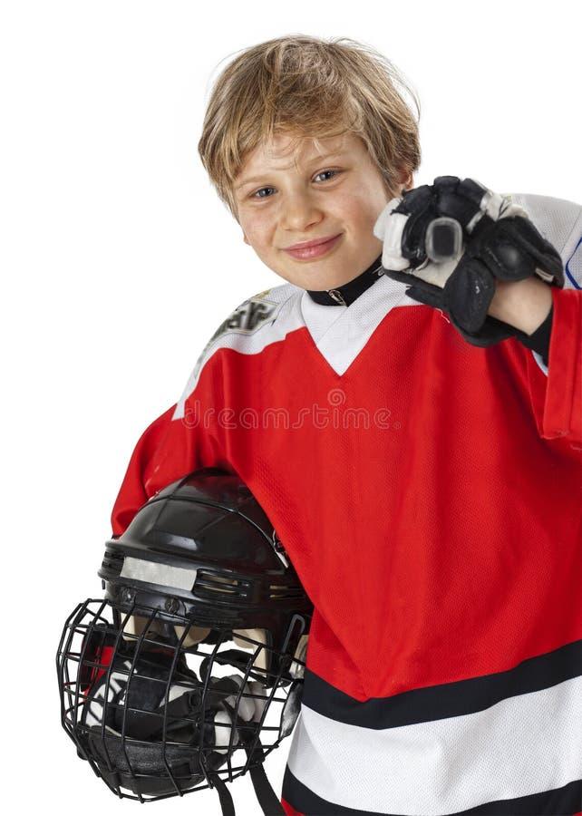 曲棍球运动员年轻人 免版税库存图片