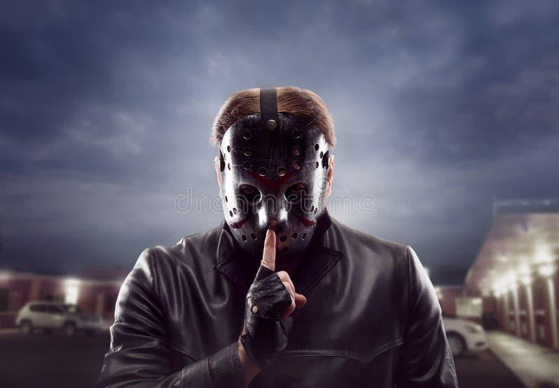曲棍球面具展示的血淋淋的疯子不谈标志 库存图片