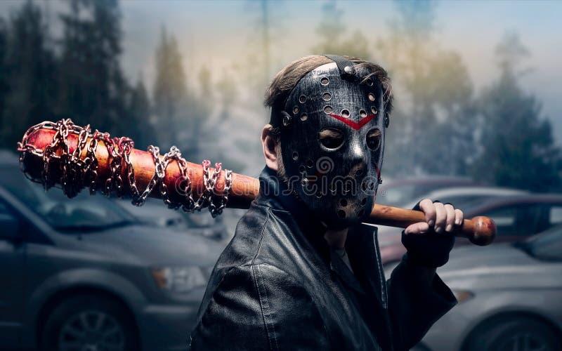 曲棍球面具的血淋淋的疯子 免版税库存图片