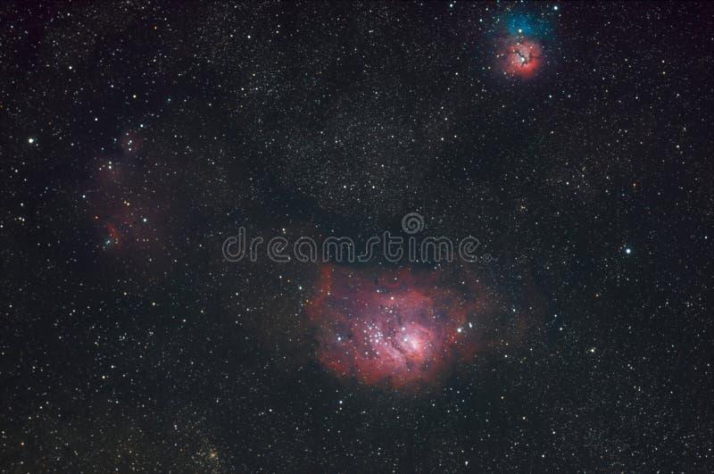 更加杂乱的8个盐水湖星云和更加杂乱20三裂星云 库存图片