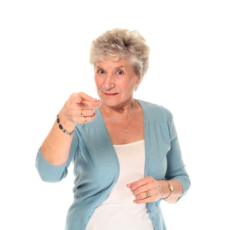 更老的指向的高级妇女 免版税库存图片