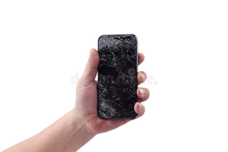 曼谷,泰国- 2019年4月2日:人拿着有残破的显示的新的苹果计算机iPhone x智能手机,举行由在白色的一只手在 图库摄影