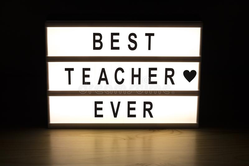 最佳的老师灯箱标志板 免版税图库摄影