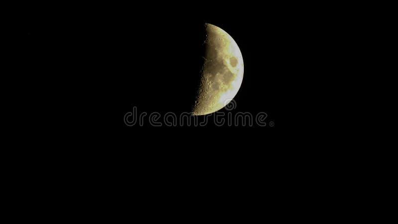 月亮的照片在黑背景的 库存图片