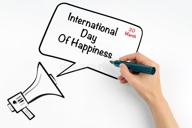 3月20日国际天幸福 扩音机和文本在白色背景 库存图片