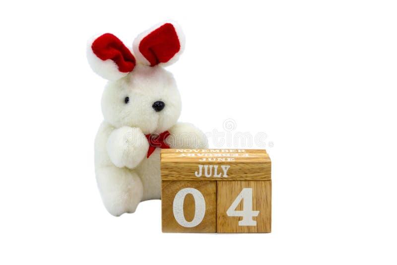 7月4日在木立方体的文本 库存图片