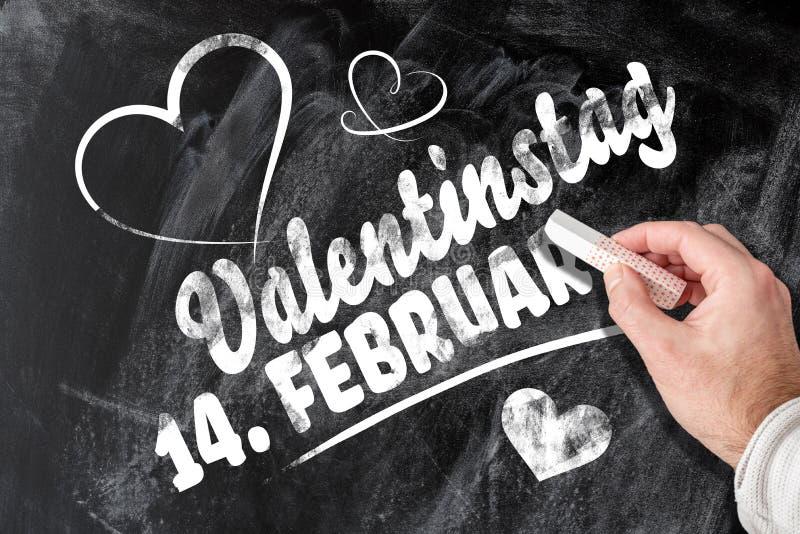 2月14日情人节提示用在黑板写的德语 免版税库存照片