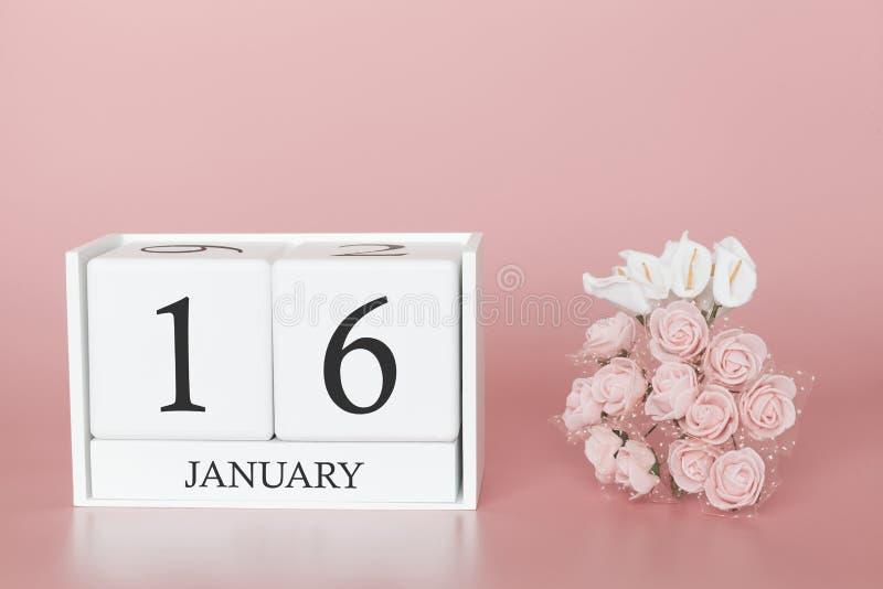 1月16日 天16月 在现代桃红色事务的背景、概念和一个重要事件的日历立方体 免版税库存图片