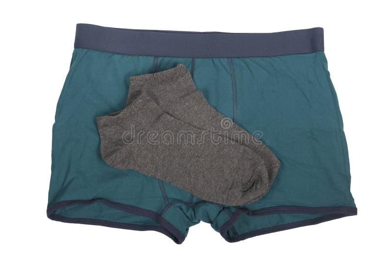 有一个对的绿色拳击手灰色袜子 库存图片