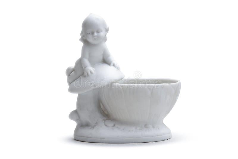 有一个小男孩的白色瓷花瓶 图库摄影