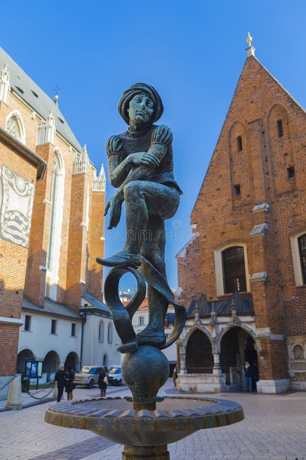 有一个工匠男孩的雕塑的喷泉在克拉科夫 免版税库存图片