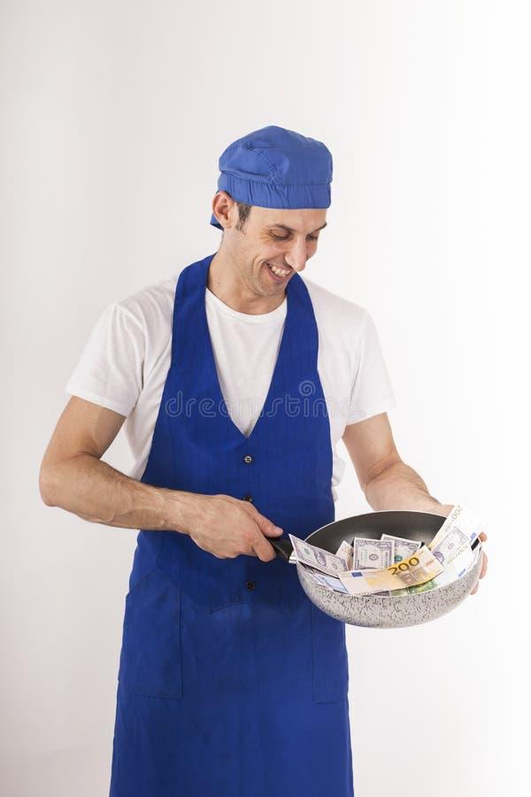 有一个平底锅的厨师钞票 免版税图库摄影
