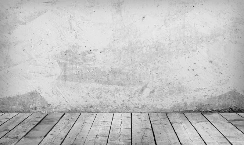 有一个混凝土墙和木地板的室 免版税库存照片
