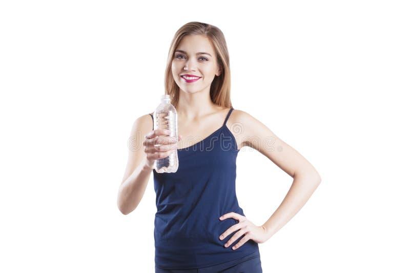 有一个瓶的运动的女孩水 免版税图库摄影