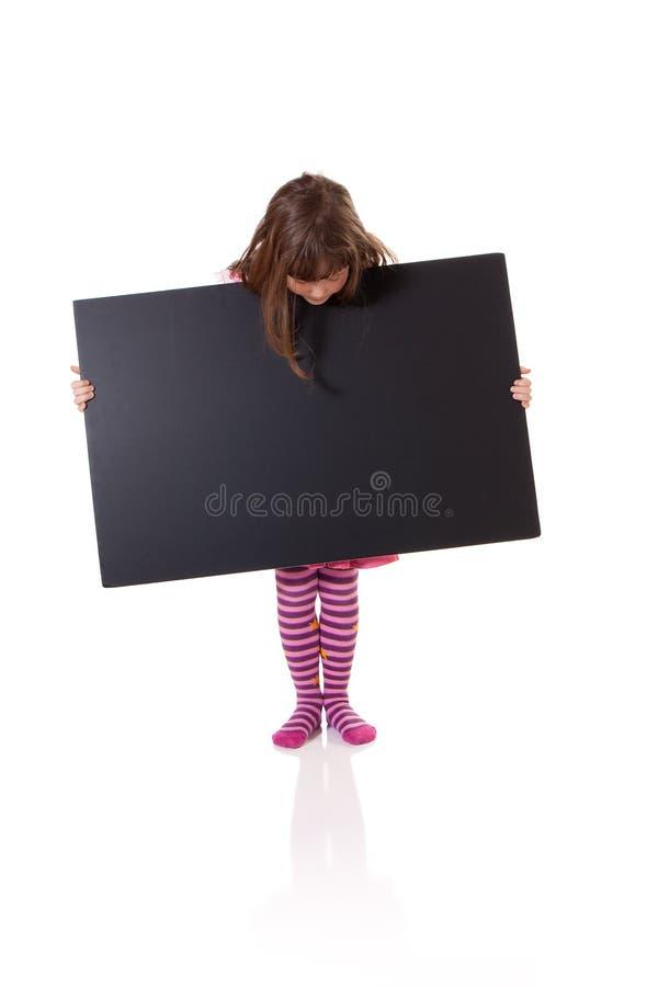 有一个空白的标志的女孩 免版税库存图片