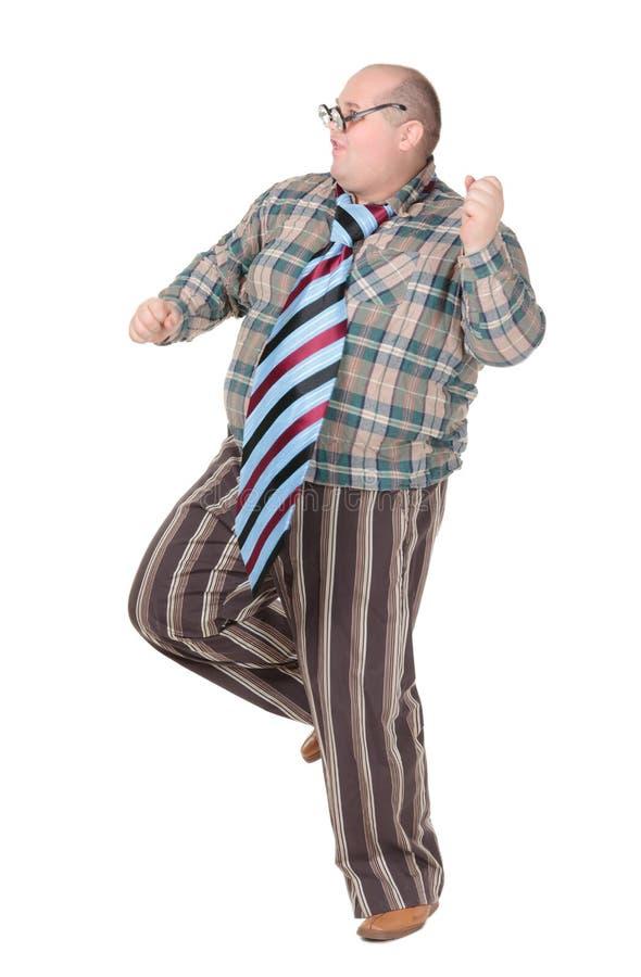 有一个粗暴的流行观念的肥胖人 免版税库存照片