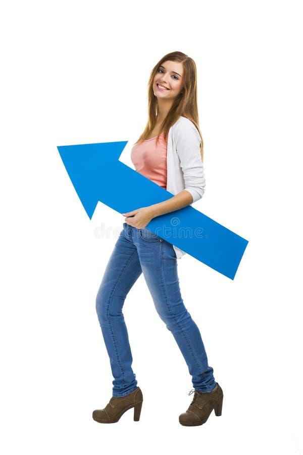 有一个蓝色箭头的妇女 库存照片