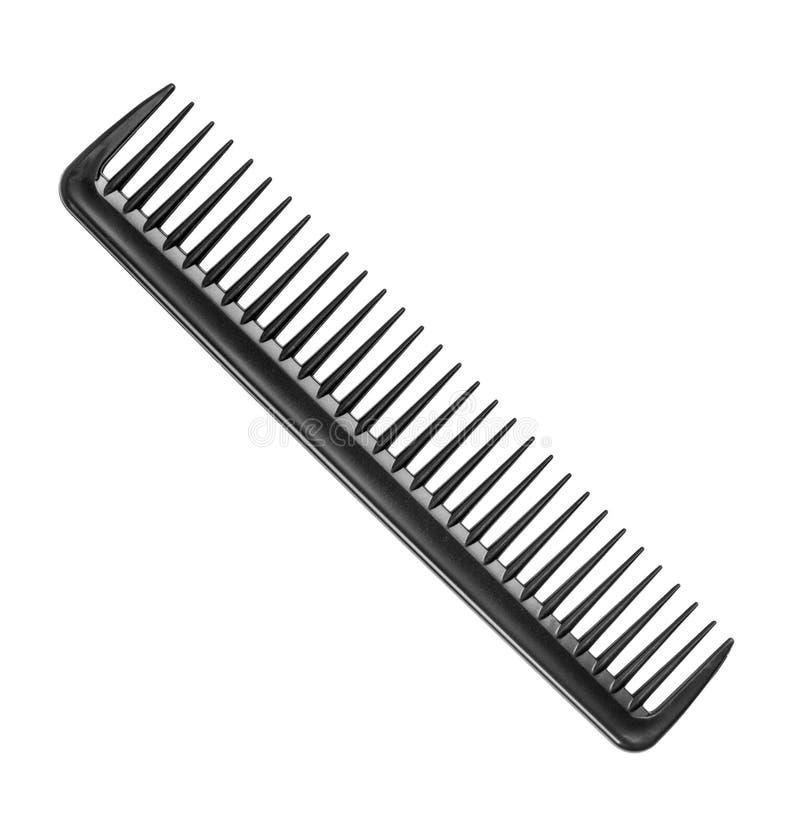 有一些颗牙的黑理发师梳子 免版税图库摄影