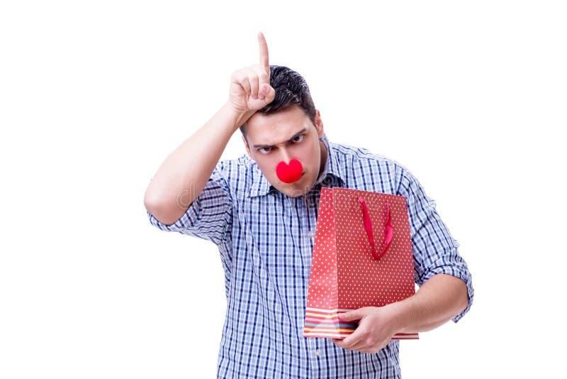 有一件红色鼻子滑稽的藏品的人购物袋礼物礼物是 免版税库存照片