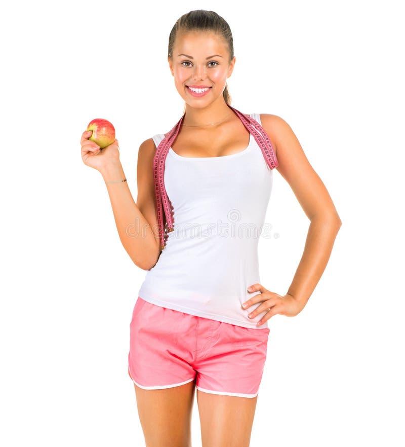 有一卷测量的磁带的健身妇女 图库摄影