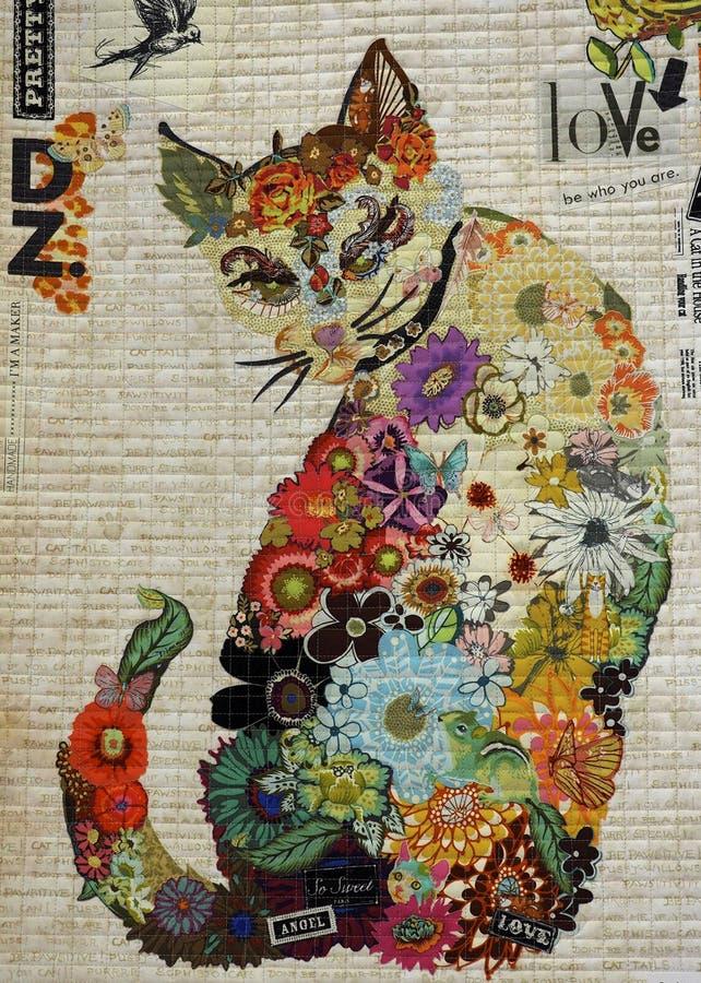 有一只多彩多姿的猫的当代被子 库存照片