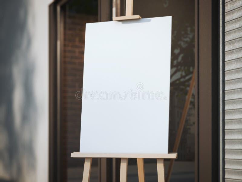 有一块白色帆布的木画架在街道上 库存照片