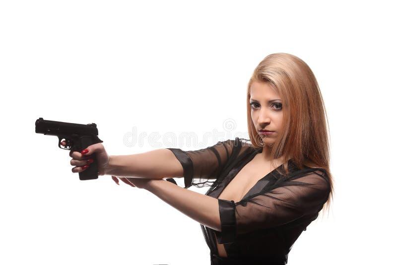 有一杆枪的典雅的时髦的女人在手上 库存图片