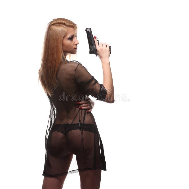 有一杆枪的典雅的时髦的女人在手上 库存照片