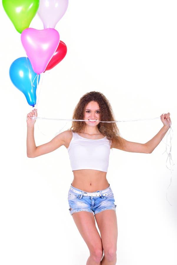 有一束的女孩心形的气球 库存照片