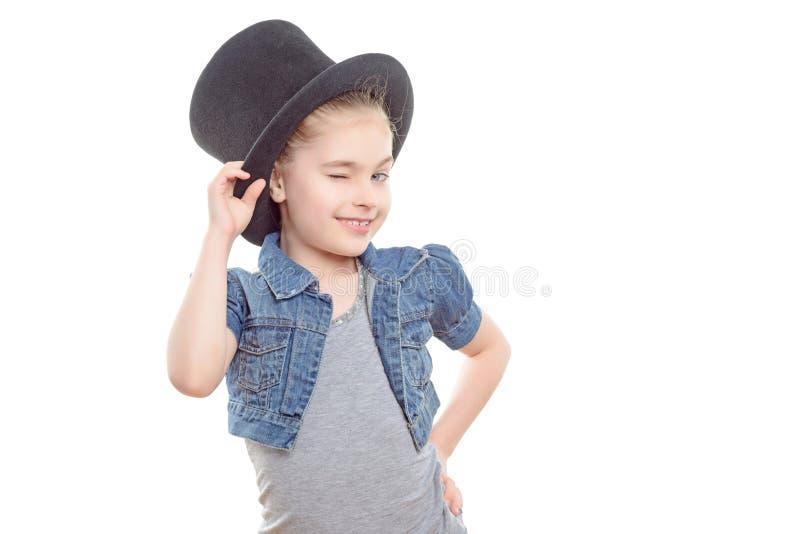 有一顶高顶丝质礼帽的小女孩 库存图片