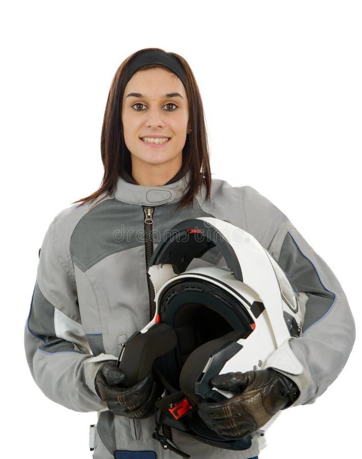 有一件摩托车盔甲的美丽的女孩,在白色 免版税库存照片