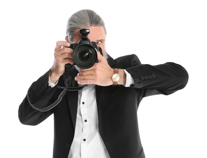 有专业照相机的男性摄影师 库存图片