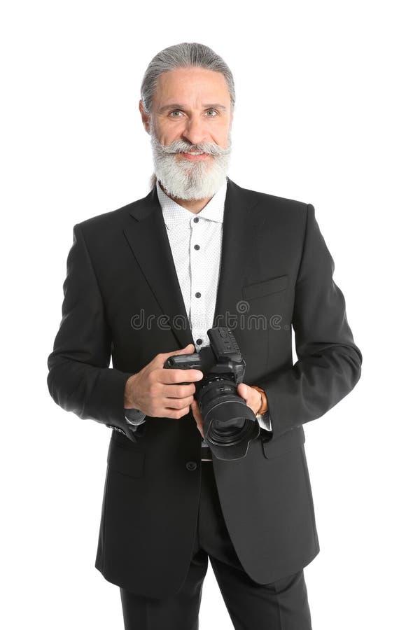 有专业照相机的男性摄影师 库存照片