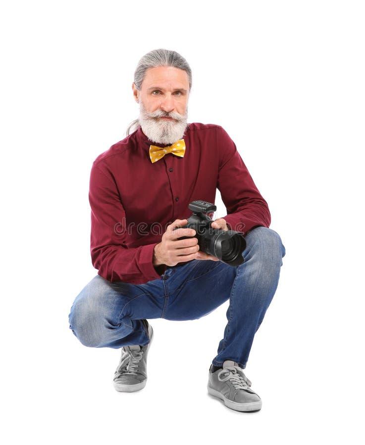 有专业照相机的男性摄影师 免版税库存图片