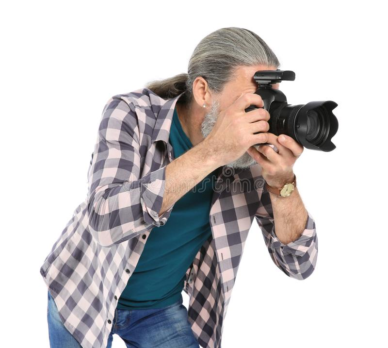 有专业照相机的男性摄影师 免版税图库摄影