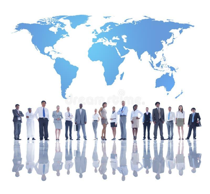 有世界地图的国际商业人 库存照片