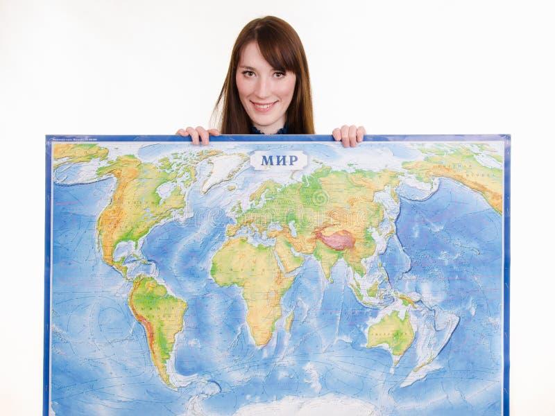 有世界地图的女孩 库存照片
