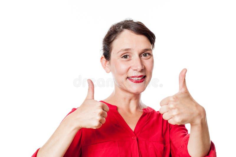 有两赞许批准的快乐的30s妇女 免版税库存图片