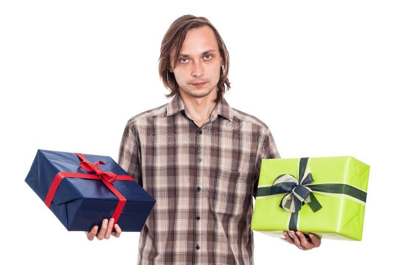 有两件礼物的严肃的人 库存图片