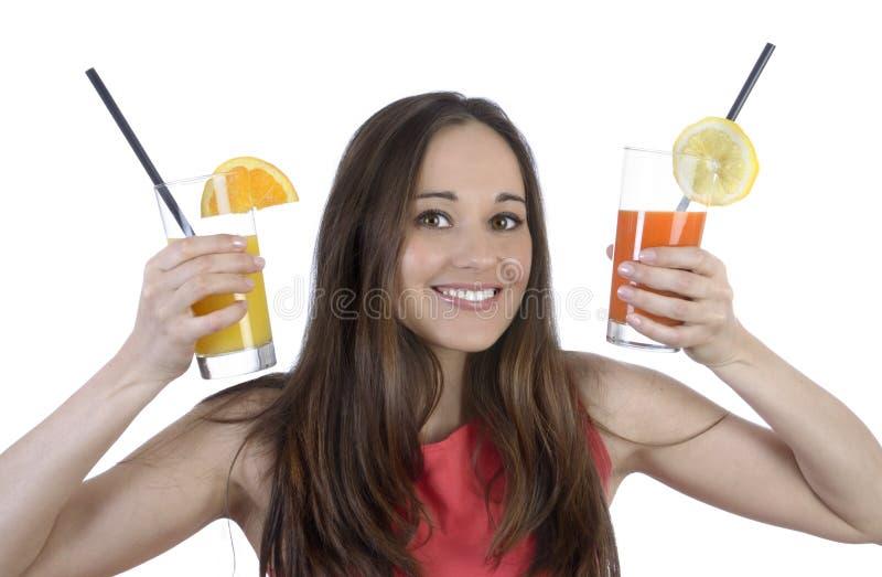 有两份饮料的俏丽的妇女 免版税库存照片