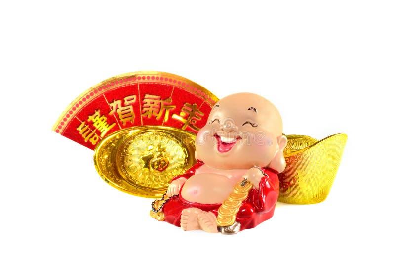 有中国金锭装饰的微笑的菩萨 库存图片