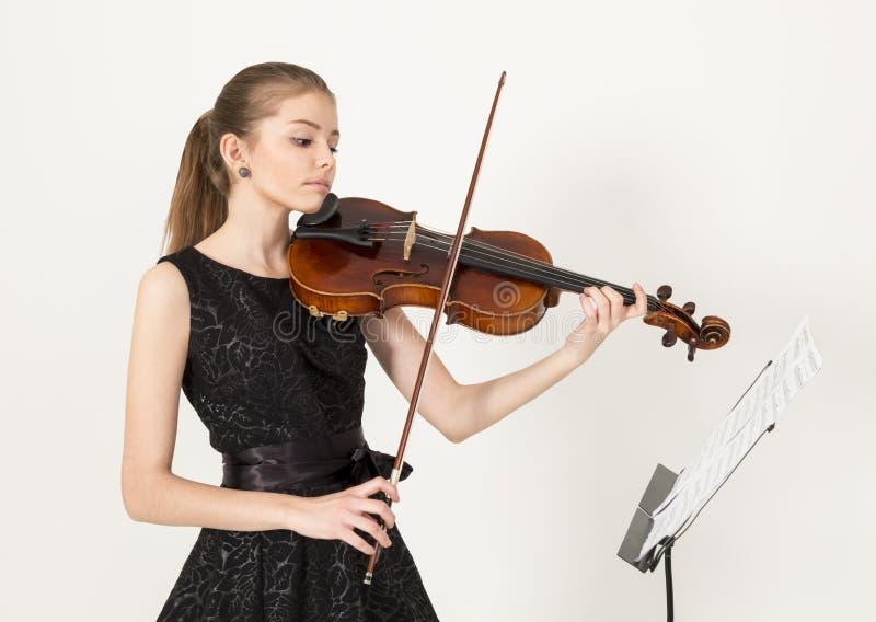 有中提琴的十几岁的女孩 库存图片