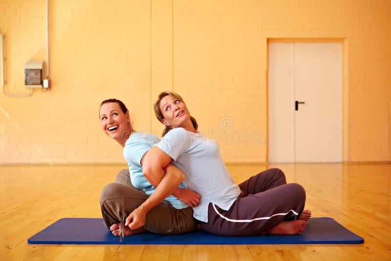 有乐趣的体操妇女 免版税图库摄影