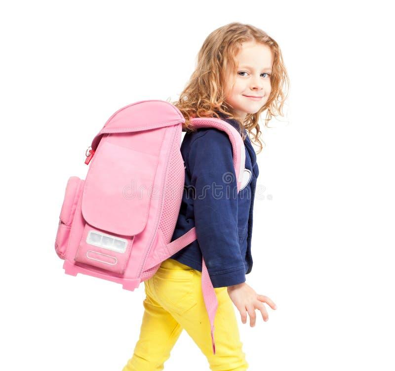 有书包的小女孩 免版税库存图片