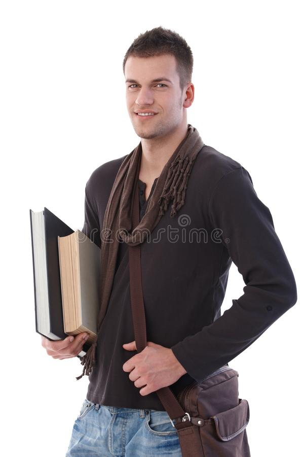 有书微笑的大学生 库存图片