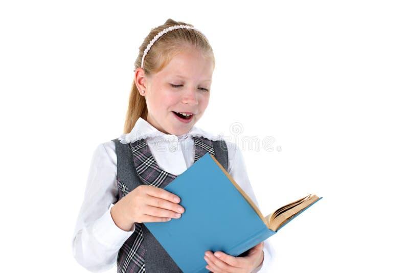 有书的八岁的学校女孩 库存图片
